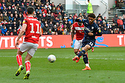 Tyler Roberts (11) of Leeds United shoots at goal during the EFL Sky Bet Championship match between Bristol City and Leeds United at Ashton Gate, Bristol, England on 9 March 2019.