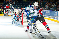 KELOWNA, CANADA - OCTOBER 7: Colby Cave #10 of Swift Current Broncos skates with the puck as Colten Martin #8 of Kelowna Rockets back checks during second period on October 7, 2014 at Prospera Place in Kelowna, British Columbia, Canada.  (Photo by Marissa Baecker/Getty Images)  *** Local Caption *** Colten Martin; Colby Cave;