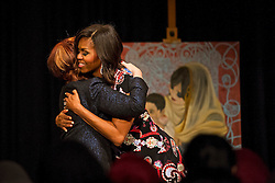 © Licensed to London News Pictures. 16/06/2015. London, UK. L to R First lady MICHELLE OBAMA hugging former prime minister of Australia JULIAN GILLARD at the ned of a questions and answers session during a visit to Mulbery School For Girls in east London. Photo credit: Ben Cawthra/LNP
