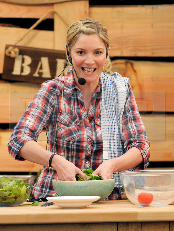 © Licensed to London News Pictures. 10/05/2014; Bristol, UK.  Lisa Faulkner does a live demonstration of cooking chicken kievs at the Bristol Food Connections festival in the Harbourside area of the city.<br /> Photo credit: Simon Chapman/LNP