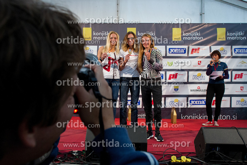Photographer, Vid Ponikvar taking a picture of Tina Cacilo, Daneja Grandovec and Neza Mravlje 3. Konjiski maraton / 3rd Marathon of Slovenske Konjice, on September 27, 2015 in Slovenske Konjice, Slovenia. Photo by Urban Urbanc / Sportida