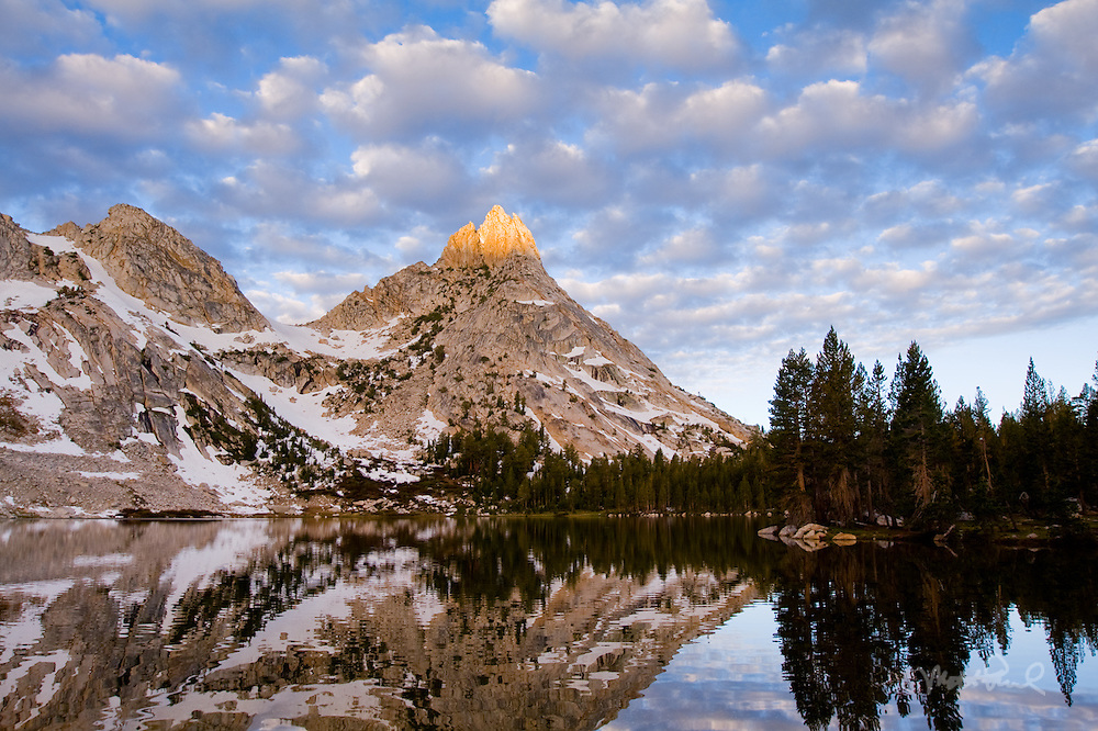 Backpacked three days into the Yosemite backcountry. Our destination was Young Lakes and then the next day to hike Mt Conness. We woke up to this cloudy sky I scrambled to the capture the sunlight on Ragged Peak and the placid reflection of Young Lake