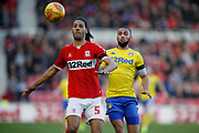 Middlesbrough defender Ryan Shotton (5) shields the ball from Leeds United midfielder Kemar Roofe (7)  during the EFL Sky Bet Championship match between Middlesbrough and Leeds United at the Riverside Stadium, Middlesbrough, England on 9 February 2019.