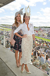 Left to right, LAURA WHITMORE and MILLIE MACKINTOSH at the Investec Derby 2015 at Epsom Racecourse, Epsom, Surrey on 6th June 2015.