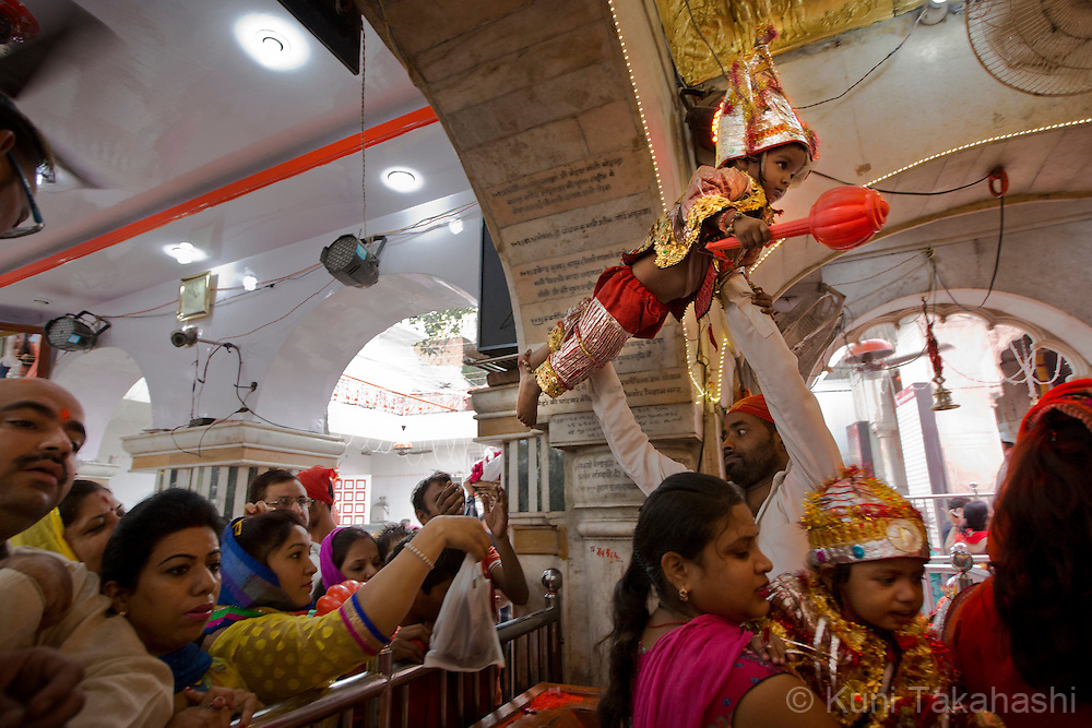 A child is lifted up to pay respect to Hanuman, one of Hindu gods, at Sri Durgiana Temple in Amritsar, Punjab, India on Oct 20, 2015, during Langur, Hindu festival to celebrate Hauman. <br /> (Photo by Kuni Takahashi)