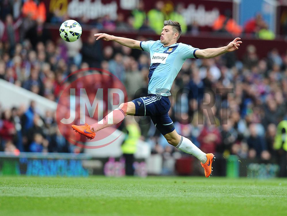 West Ham United's Aaron Cresswell stretches for the ball  - Photo mandatory by-line: Joe Meredith/JMP - Mobile: 07966 386802 - 09/05/2015 - SPORT - Football - Birmingham - Villa Park - Aston Villa v West Ham United - Barclays Premier League