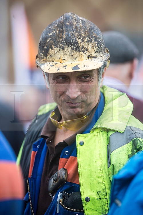 © Licensed to London News Pictures. 10/11/2015. Scunthorpe, UK. A march in Scunthorpe has taken place to support the 900 Tata Steel workers who are to be made redundant at the Steel plant. The industry blames cheap Chinese imports for a collapse in steel prices. Tata has pledged £3m to help create jobs in the town, with another £6m provided by the government. Photo credit: Andrew McCaren/LNP