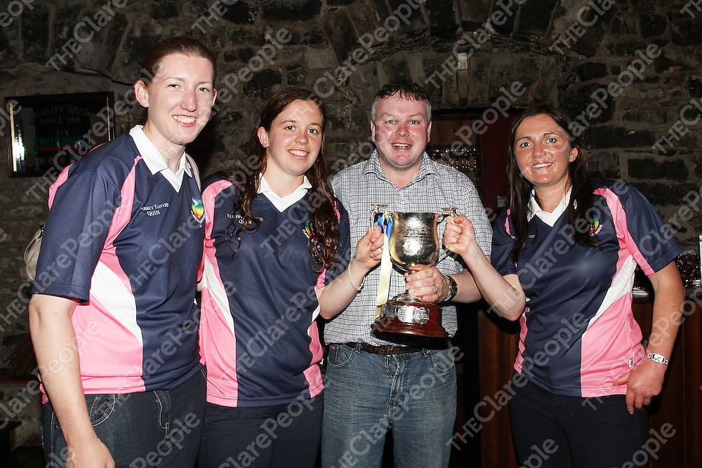 Denise Lynch, Aisling Hannon, John Carmody (Manager) & Claire McMahon celebrating their win over Cork in the Munster Senior Camogie Final. - Photograph by Flann Howard