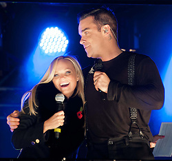(LtoR) Emma Bunton with Robbie Williams, during the Marmite Oxford Street Christmas Lights switch-on.  Robbie Williams switches on this year's Christmas lights on the London High Street, hosted by House of Fraser with support from Lewis and boyband Lawson. Theakston and Bunton from Heart 106.2 present, Oxford Street, London, United Kingdom., Oxford Street, London, United Kingdom, November 5, 2012. Photo by Nils Jorgensen / i - Images.