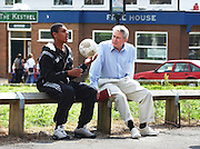 PHOTOGRAPH BY HOWARD BARLOW.FESTIVAL MANCHESTER 27-8-2003.Evangelist LOIS PALAU talking with local youth on visit to Moston in north Manchester