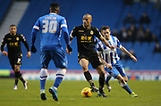 Bolton Wanderers midfielder, Darren Pratley (21) gets away from Brighton winger, Jamie Murphy (15) during the Sky Bet Championship match between Brighton and Hove Albion and Bolton Wanderers at the American Express Community Stadium, Brighton and Hove, England on 13 February 2016.