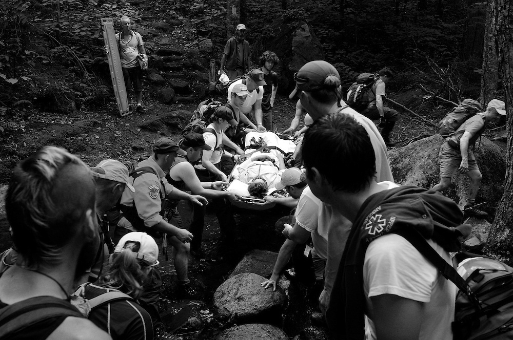 Rescuers from Upper Valley Ambulance, New Hampshire Fish and Game and Upper Valley Wilderness Response help pass injured Christina Brownell, of Hanover, over a creek crossing the Appalachian Trail on Mount Cube yesterday in Orford. Brownell, 47, was injured when she fell on a hike with her family. <br /> Valley News - James M. Patterson<br /> jpatterson@vnews.com<br /> photo@vnews.com