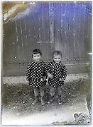 twin dressed girls vintage eroding glass plate photograph
