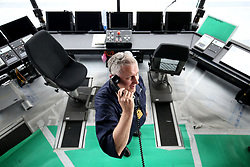 Commander Air Mark Deller makes final preparations in the flight control tower ahead of sea trials this summer, for the Royal Navy's new aircraft carrier HMS Queen Elizabeth, at Rosyth Dockyard in Dunfermline.