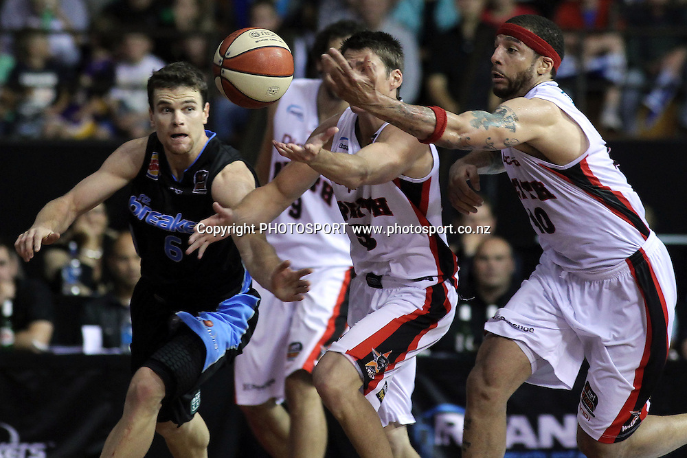 Breakers' Kirk Penney battles for the ball against Wildcats' Damian Martin and Andre Brown. iinet ANBL, Semi-Finals Game 1, New Zealand Breakers vs Perth Wildcats, North Shore Events Centre, Auckland, New Zealand. Thursday 7th April 2011. Photo: Anthony Au-Yeung / photosport.co.nz