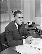 23/9/1952<br /> 9/23/1952<br /> 23 September 1952<br /> <br /> National Cash Register Mr. A.M. Davie at his desk