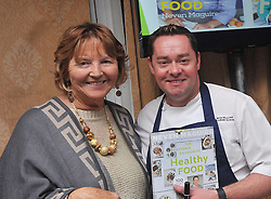 Maureen Flynn with Neven Maguire at the cookery demonstration in aid of the Aoife Beary fund at Hotel Westport on friday last.Pic Conor McKeown