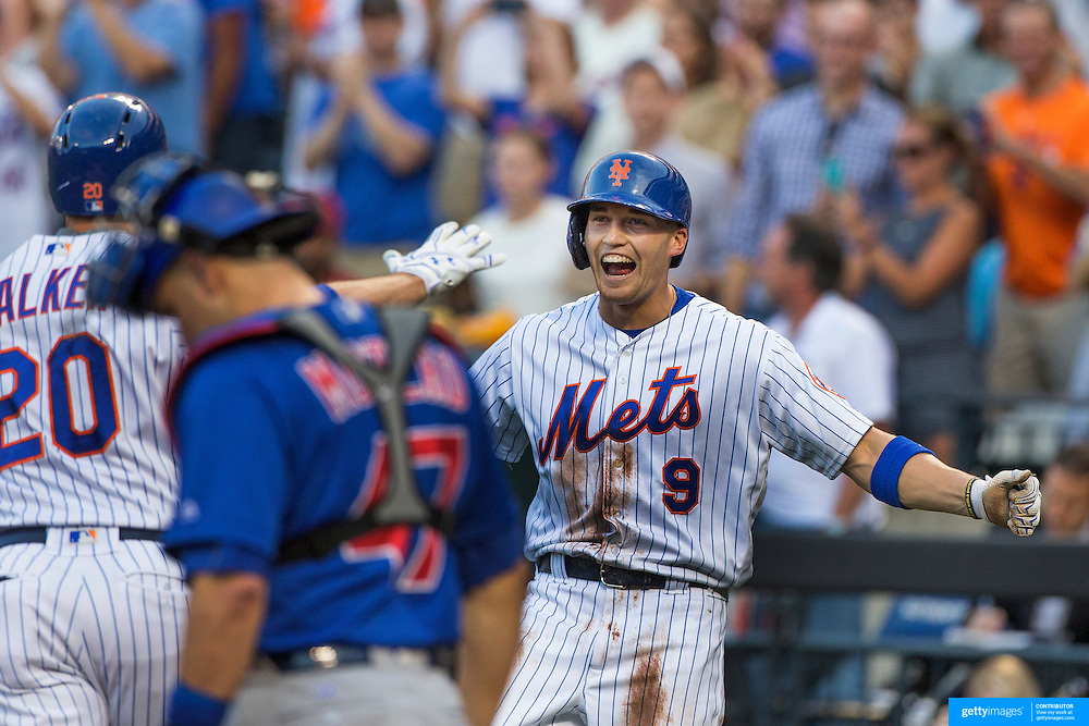 NEW YORK, NEW YORK - July 02: Brandon Nimmo #9 of the New York Mets shows his delight on scoring off Neil Walker #20 of the New York Mets two run first inning homer during the Chicago Cubs Vs New York Mets regular season MLB game at Citi Field on July 02, 2016 in New York City. (Photo by Tim Clayton/Corbis via Getty Images)