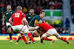 South Africa Fly-Half Handre Pollard is tackled by Wales Flanker Sam Warburton (capt) - Mandatory byline: Rogan Thomson/JMP - 07966 386802 - 17/10/2015 - RUGBY UNION - Twickenham Stadium - London, England - South Africa v Wales - Rugby World Cup 2015 Quarter Finals.