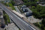 Nederland, Zuid-Holland, Voorburg, 12-05-2009; Station Voorburg naast de A12 (verlengde van de Utrechtsebaan) met op het Stationsplein horeca (Movenpick hotel, restauarant) en een akntoorgebouw (Deloitte).Swart collectie, luchtfoto (toeslag); Swart Collection, aerial photo (additional fee required); .foto Siebe Swart / photo Siebe Swart