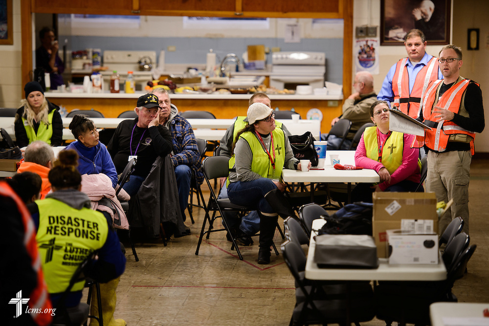 Stephen Born (far right), regional disaster-response coordinator for the LCMS Central Illinois District (CID), addresses volunteers before a cleanup event of flood-damaged homes on Saturday, Jan. 9, 2016, at Calvary Lutheran Church in Watseka, Ill. A flood at the end of December ravaged over a 60-block radius of the town. LCMS Communications/Erik M. Lunsford