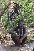 Hadza tribesman sitting Photographed at Lake Eyasi, Tanzania