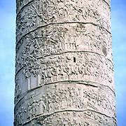 Trajan's column, Rome, Italy. Erected by emperor Trajan 106-113 and carved in low relief with narrative of his two campaigns in Dacia. Now topped with statue of St Peter.