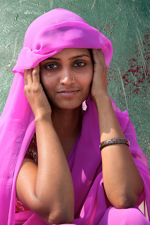 Portrait of a beautiful young woman wearing a pink sari (India)
