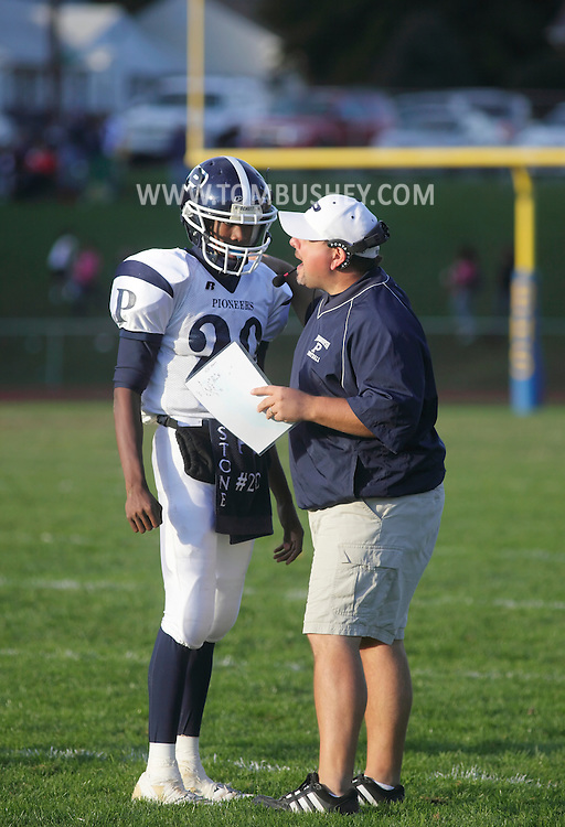 Beacon, New York - A Poughkeepsie coach talks to a player during a high school football game against Beacon on Saturday, Oct. 10, 2009.