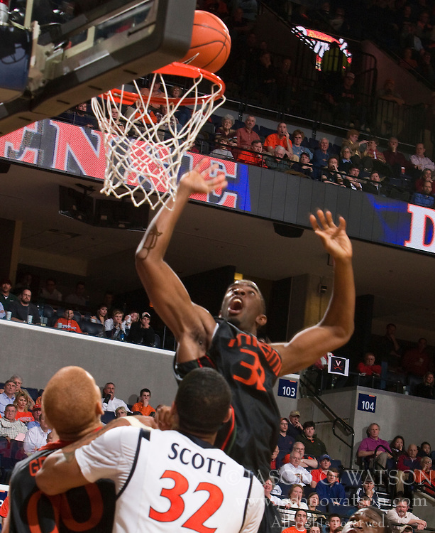 Miami (FL) forward Brian Asbury (32) completes a layup against UVA.  The Virginia Cavaliers fell to the Miami Hurricanes 62-55 at the John Paul Jones Arena on the Grounds of the University of Virginia in Charlottesville, VA on February 26, 2009.