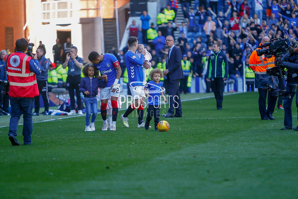 Rangers Captain James Tavernier comes back out onto the pitch with his family following their last home game of the season during the Ladbrokes Scottish Premiership match between Rangers and Celtic at Ibrox, Glasgow, Scotland on 12 May 2019.