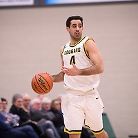 5th year guard Alex Igual (4) of the Regina Cougars in action during the home opener on November  10 at Centre for Kinesiology, Health and Sport. Credit: Arthur Ward/Arthur Images