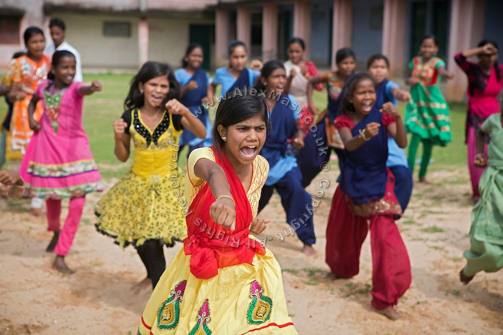 Tabasum Khatun, 14, is throwing a punch during a Karate class in Algunda village, pop. 1000, Giridih District, rural Jharkhand, India.