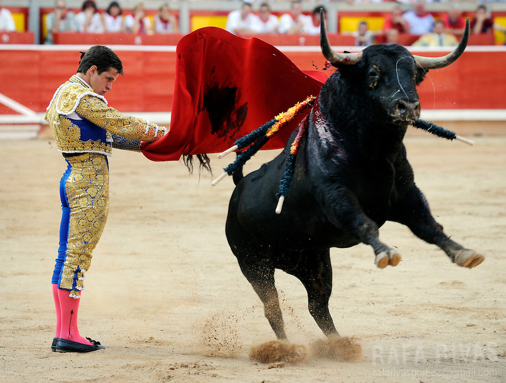 Spanish matador El Juli fights a fighting bull during a corrida at the bull-ring of Pamplona, North of Spain, on July 12, 2010, during the San Fermin festival. Photo Rafa Rivas