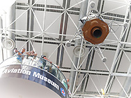 Garden City, New York, U.S. July 20, 2019. Visitors look down from high landing on the 3rd floor staircase near the 1/3 scale model of Apollo 11 Lunar Module The Eagle suspended from ceiling and ready to descend at the exact time the Apollo 11 Lunar Module, The Eagle, landed on the Moon 50 years ago, at the Apollo at 50 Countdown Celebration at Cradle of Aviation Museum in Long Island.
