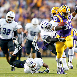 Oct 26, 2013; Baton Rouge, LA, USA; LSU Tigers running back Jeremy Hill (33) breaks loose from a tackle by Furman Paladins linebacker Cory Magwood (46) on his way to a touchdown run during the first quarter of a game at Tiger Stadium. Mandatory Credit: Derick E. Hingle-USA TODAY Sports