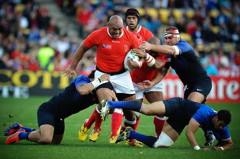 Soane Tonga'Uiha powers through French tackles during the Pool A, France v Tonga match at the IRB Rugby World Cup 2011. Wellington Regional Stadium, Wellington. Saturday 1 October 2011...Photo: Mark Tantrum/photosport.co.nz