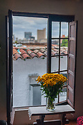 A view over the rooftops of Bogotá out the window of a café in la Candelaria neighborhood