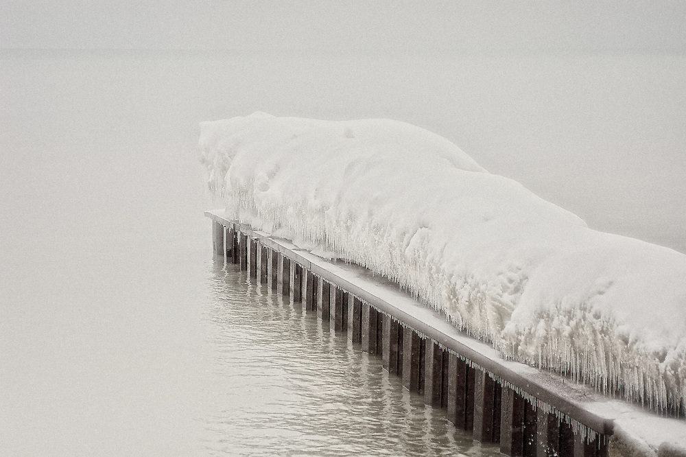 A bed of ice lays across a pier at The Beaches waterfront, Toronto Canada.