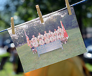 A picture of a group of scouts hangs from clothes pins during the Boy Scout Troop 180's 50th Anniversary celebration at the VFW Saturday August 22, 2015 in Croydon, Pennsylvania. (Photo by William Thomas Cain)