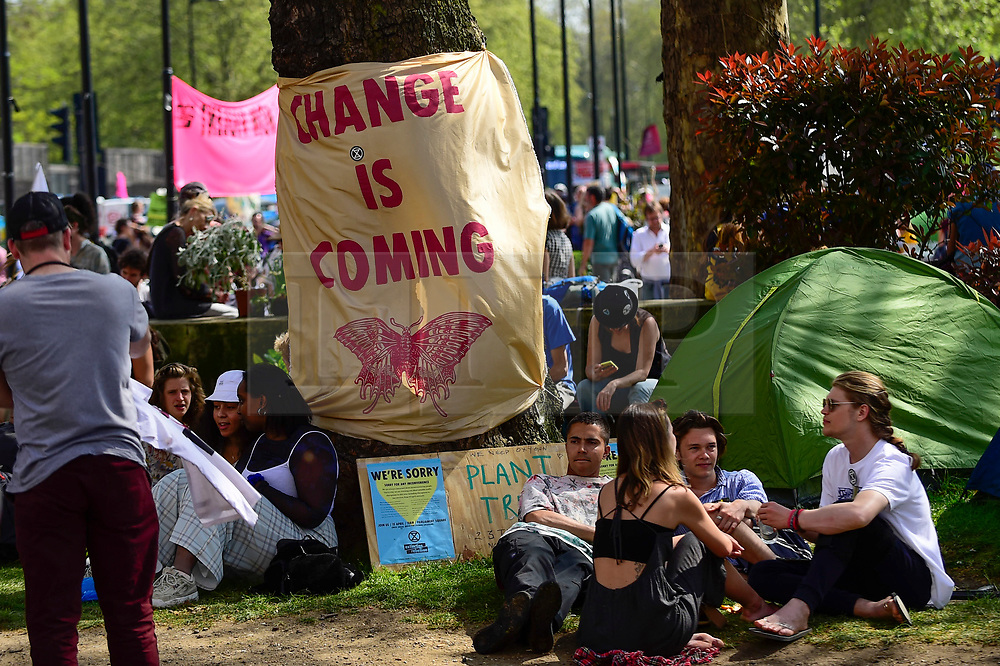 "© Licensed to London News Pictures. 22/04/2019. LONDON, UK.  Activists gather at Marble Arch during ""London: International Rebellion"", on day eight of a protest organised by Extinction Rebellion.  Protesters are demanding that governments take action against climate change.  After police issued section 14 orders at the other protest sites of Oxford Circus, Waterloo Bridge and Parliament Square resulting in over 900 arrests, protesters have convened at the designated site of Marble Arch so that the protest can continue.  Photo credit: Stephen Chung/LNP"