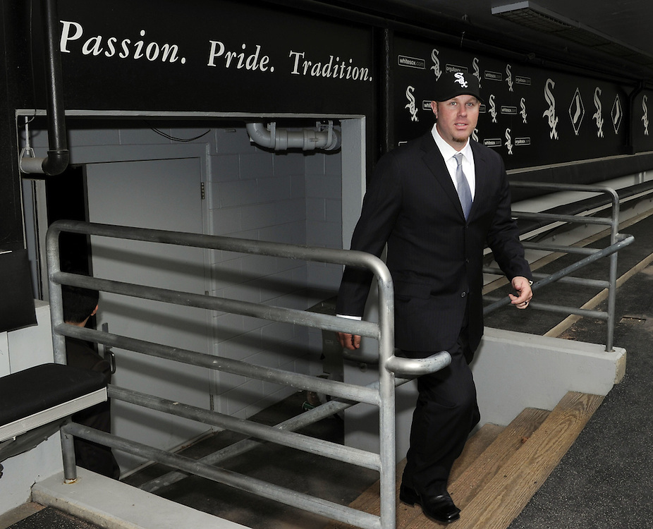 CHICAGO - DECEMBER 03:  Adam Dunn of the Chicago White Sox walks out of the White Sox dugout and onto the field after a press conference announcing his free agent signing with on December 3, 2010 at U.S. Cellular Field in Chicago, Illinois.  (Photo by Ron Vesely)