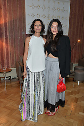 Left to right, YASMIN SEWELL and NATALIA BARBIERI at a cocktail reception to celebrate the launch of the Bicester Village the British Designer's Collective 2014 held at the The Keeper's House, Royal Academy of Art, Piccadilly, London on 20th May 2014.