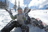 Girls 10-12 enjoy a break from snowboarding on Whistler Mountain, Whistler, BC Canada