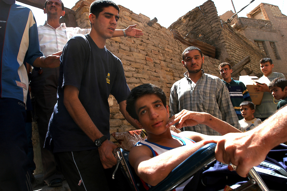 After losing his legs to a US cluster bomb, Haider Faisel Khadem Joad al-Zubaidi spent nearly two months in different hospitals before finally going home to his family in the poor and crime ridden neighborhood of Abu Sifen..Baghdad, Iraq. 13 May 2003..Photo © J.B. Russell