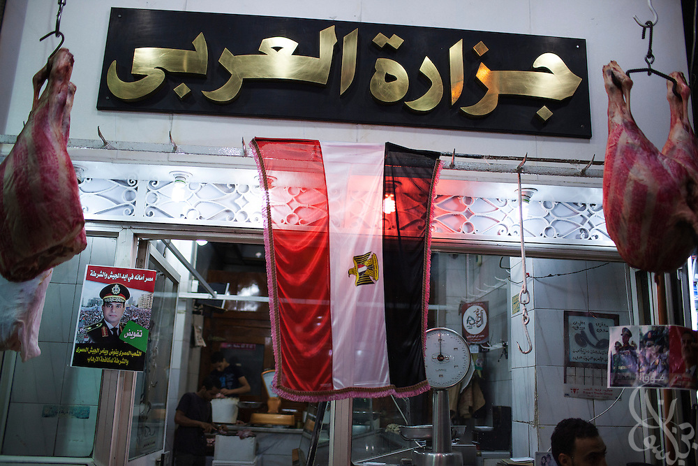 "A sign supporting Egyptian Gen. Abdel Fattah El Sissi, decorates the entrance of a butcher shop in the Dokki Square area of Giza, Egypt during massive street demonstrations called for by el Sissi , the head of Egypt's military on Friday July 26, 2013. EL Sissi had asked Egyptians to take to the streets on Friday to show the world that he had a mandate to deal with ""violence and terrorism""."