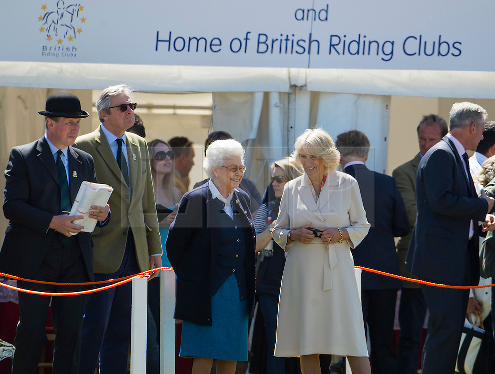 © Licensed to London News Pictures. 13/05/2015. Windsor, UK. HRH Queen Elizabeth II and Camilla, Duchess of Cornwall watch over the Cuddy Heavyweight Hunter class during day on of the 2015 Royal Windsor Horse Show, set in the grounds of Windsor castle in Berkshire, UK. Photo credit : Ben Cawthra/LNP