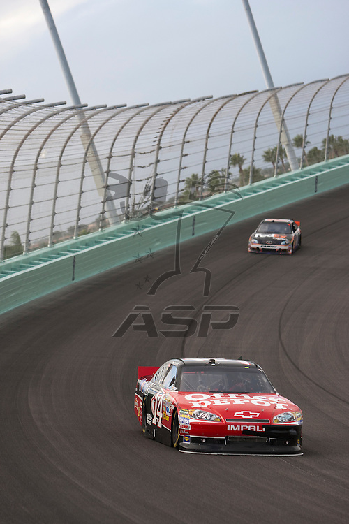 Homestead, FL - NOV 20, 2011:  Tony Stewart (14) races for the Ford 400 race at the Homestead-Miami Speedway in Homestead, FL.