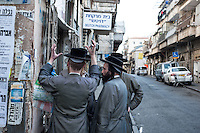 Hasidic men on the street corner of the Orthodox neighborhood of Mea Sharim, Jerusalem