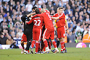 Yossi Benayoun (Liverpool) is engulfed by his team mates for scoring a late goal. Fulham v Liverpool, Barclays Premier League,  Craven Cottage,  London. 4th April 2009.